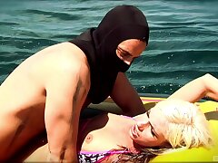 Hardcore bonking on the raft between a masked guy and a sexy blonde