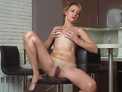 Skinny grown up plays with her furry cunt unaffected by cam