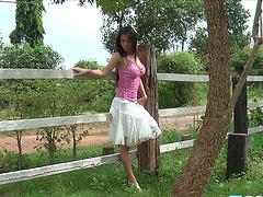 Brunette Asian teen model Loretta Tang strips naked outdoors