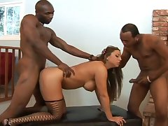 Busty cowgirl in fishnet stockings Alisandra Monroe works on two strong BBCs