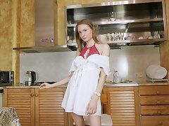 Hardly legal teen Catti Murzuk is playing with pussy on the kitchen table