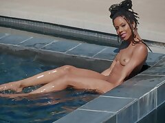 Swart honey stands nude and reveals her slutty side by the incorporate