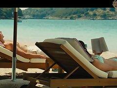 Emilia Clarke close by swim suit is sunbathing by the poolside